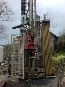 Drilling Rig for a bore hole collector