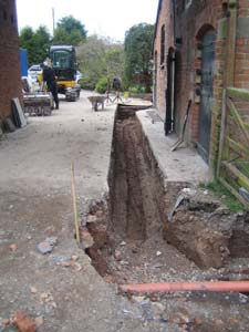 A trench alongside a property for laying a ground loop collector pipe