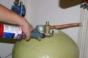 Soldering a joint in a copper water pipe to a domestic hot water tank