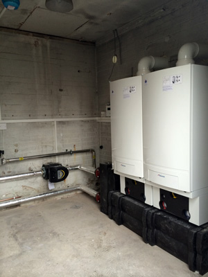 Two 65kW Worcester Bosch GB162 gas boilers installed at JCB, Wrexham