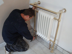A radiator / heated towel rail installation in a bathroom