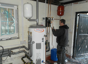 Tank and Pipework installed in an outhouse