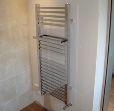 A heated towel rail installation in a bathroom